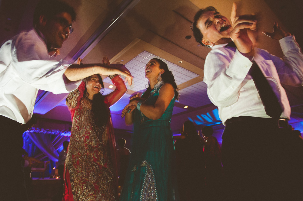 fine art wedding photography capturing creative dancing photos during cultural wedding in New Jersey