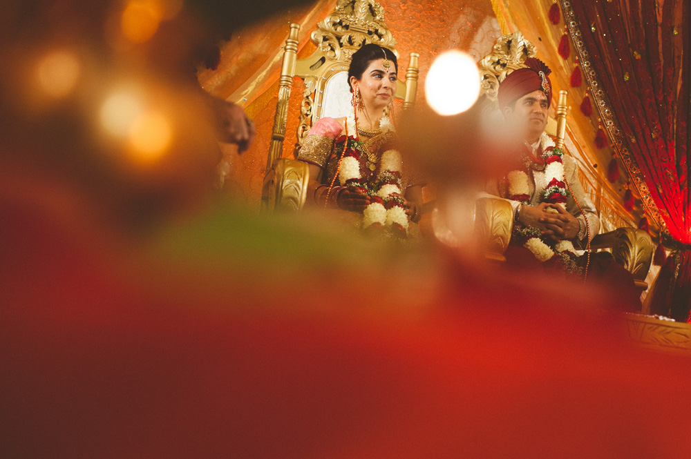 indian wedding photographer captures creatively the bride and groom during ceremony