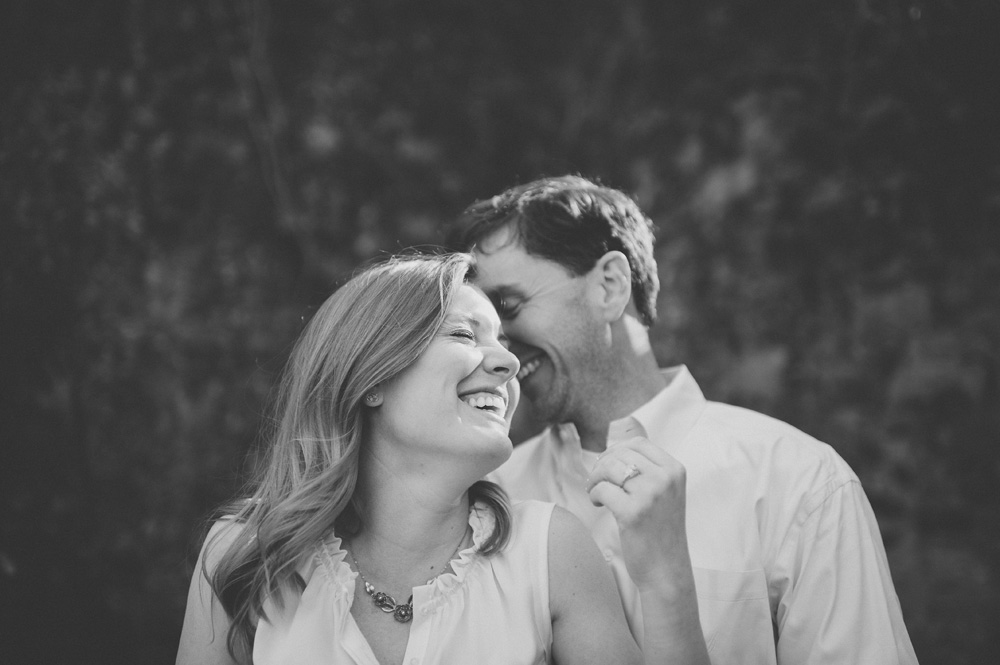 beautiful wedding photography in black and white carefree couple laughing at engagement session