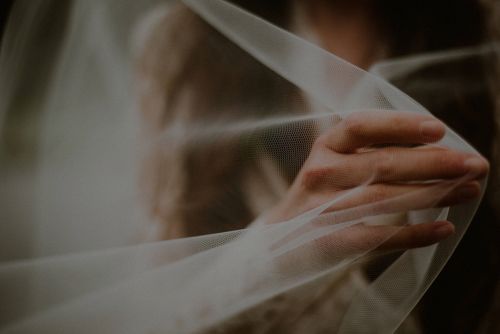 bride's hand through veil