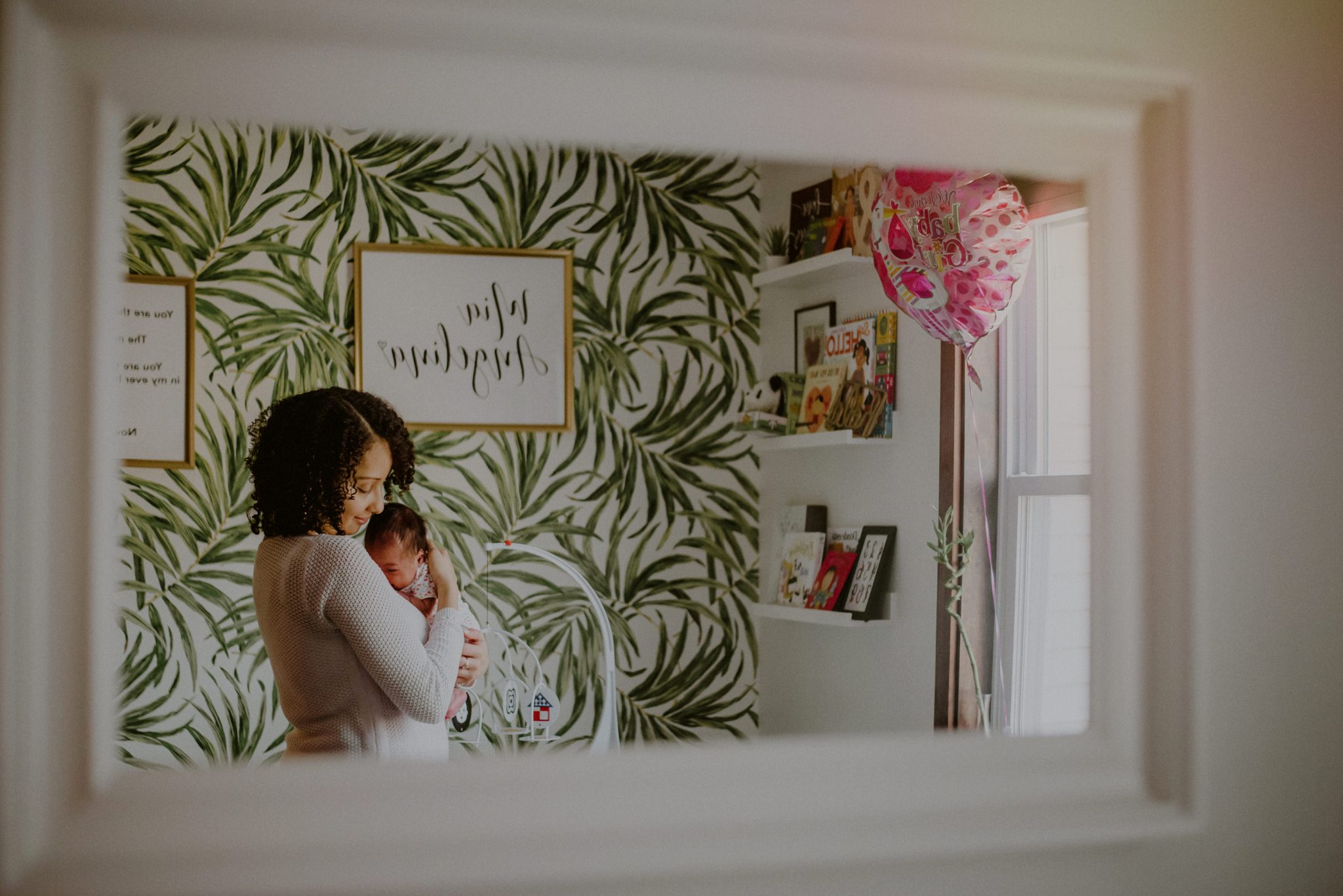 portrait of mother and baby in newly decorated newborn room