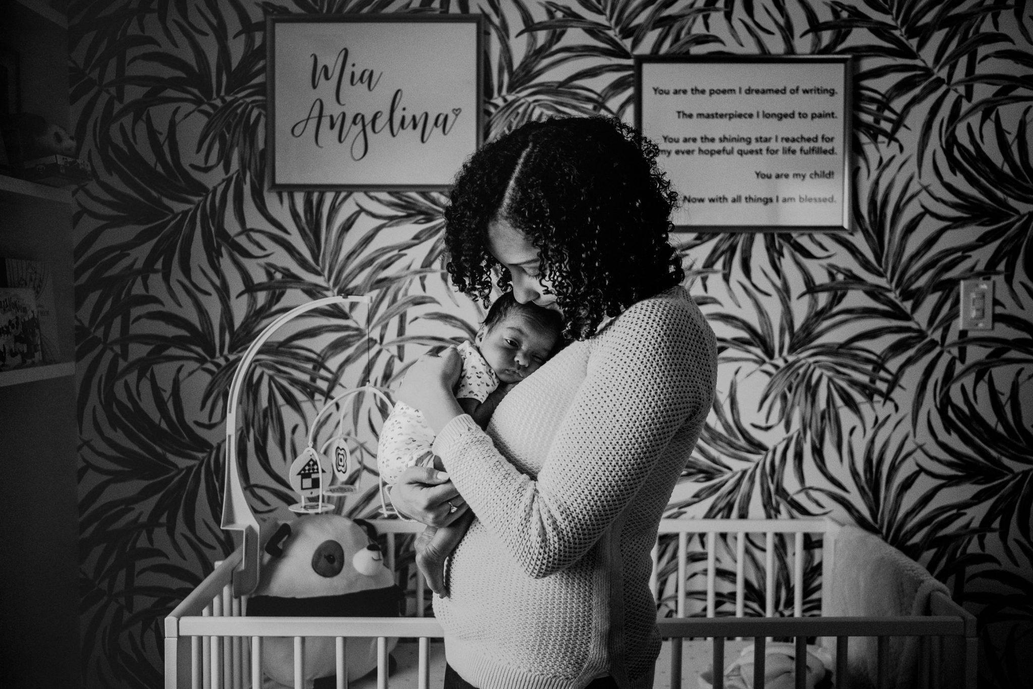 mother daughter photo in newborn baby's bedroom in black and white