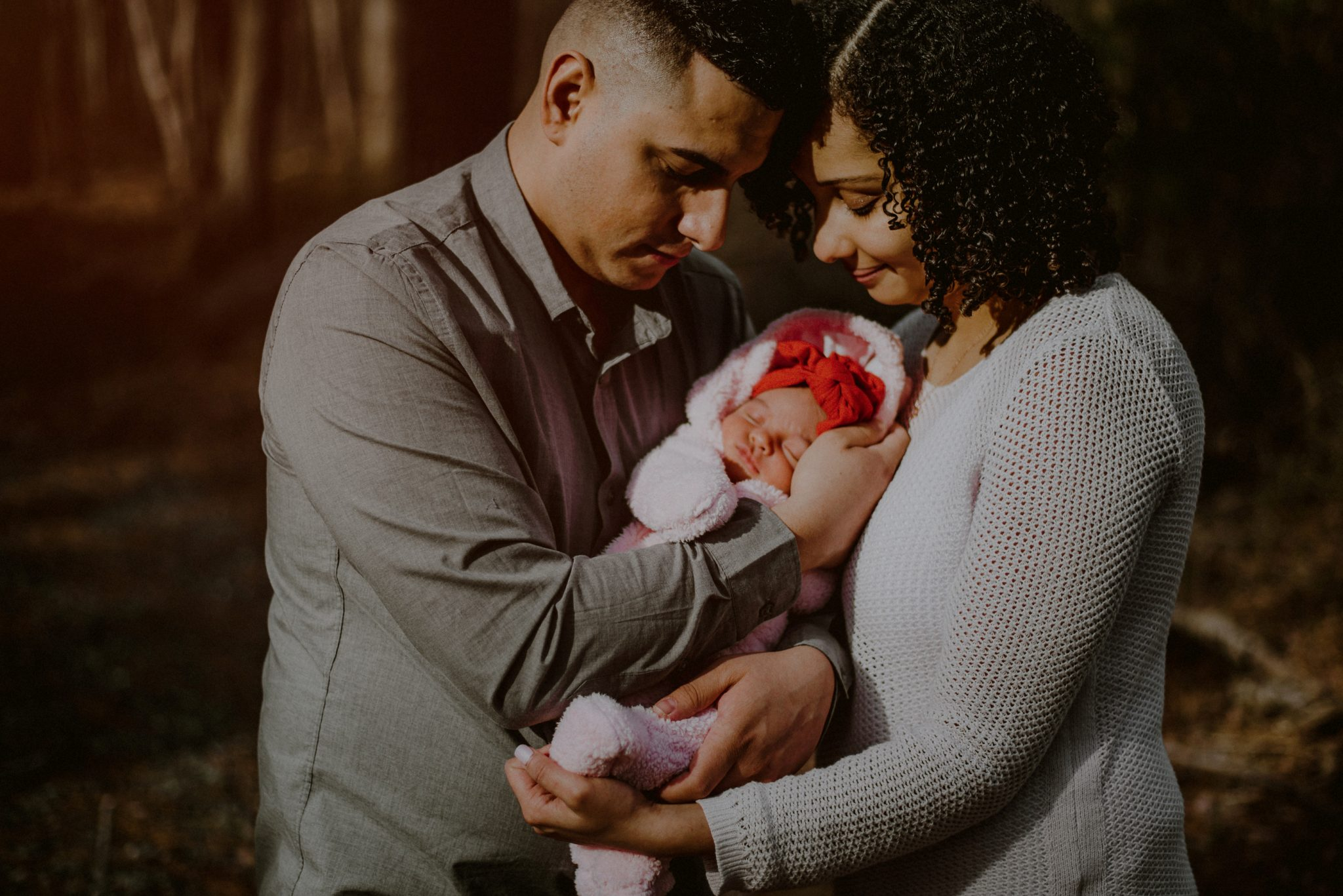family portrait in the woods with newborn baby