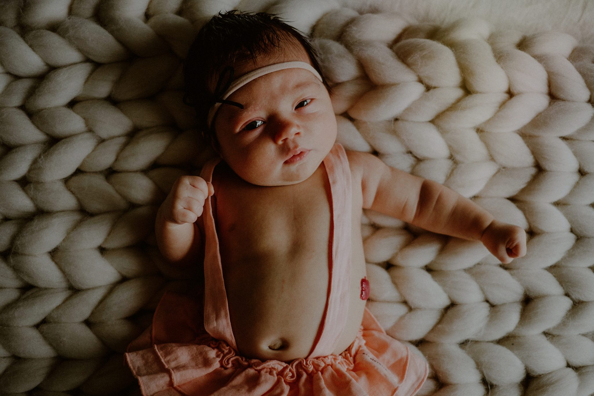 newborn baby photo with baby looking directly at camera