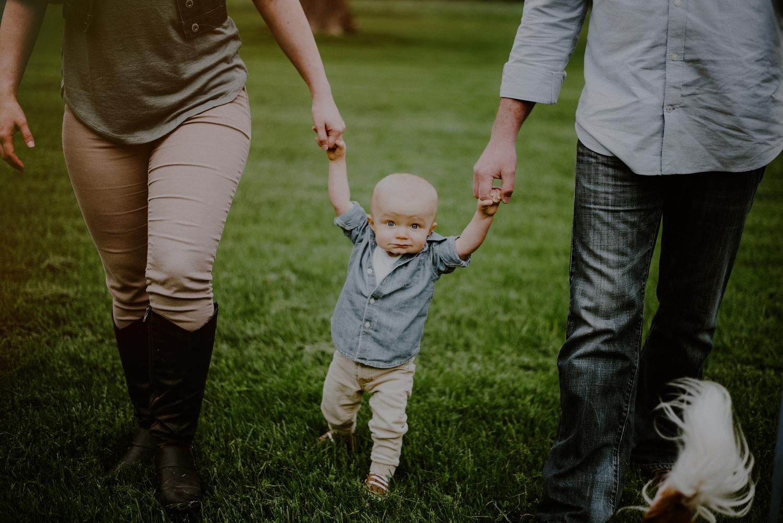 First birthday photos of toddler reaching walking milestone