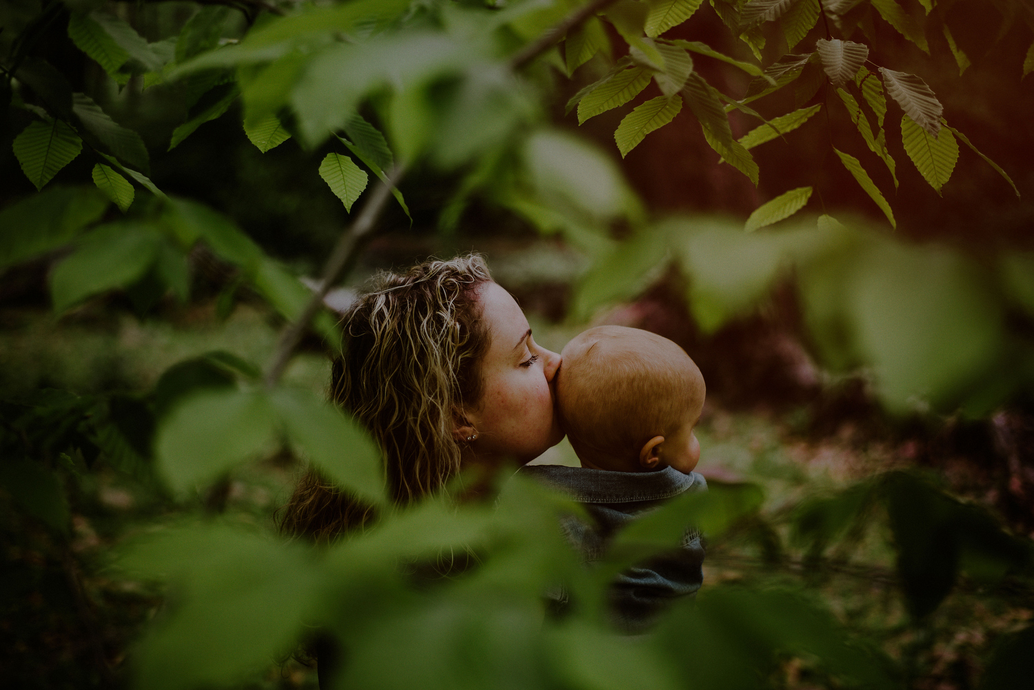 tender moment between mom and son during first birthday photo session