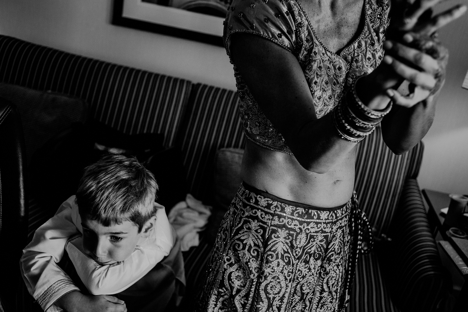 indian bride getting ready next to son in hotel in Randolph NJ