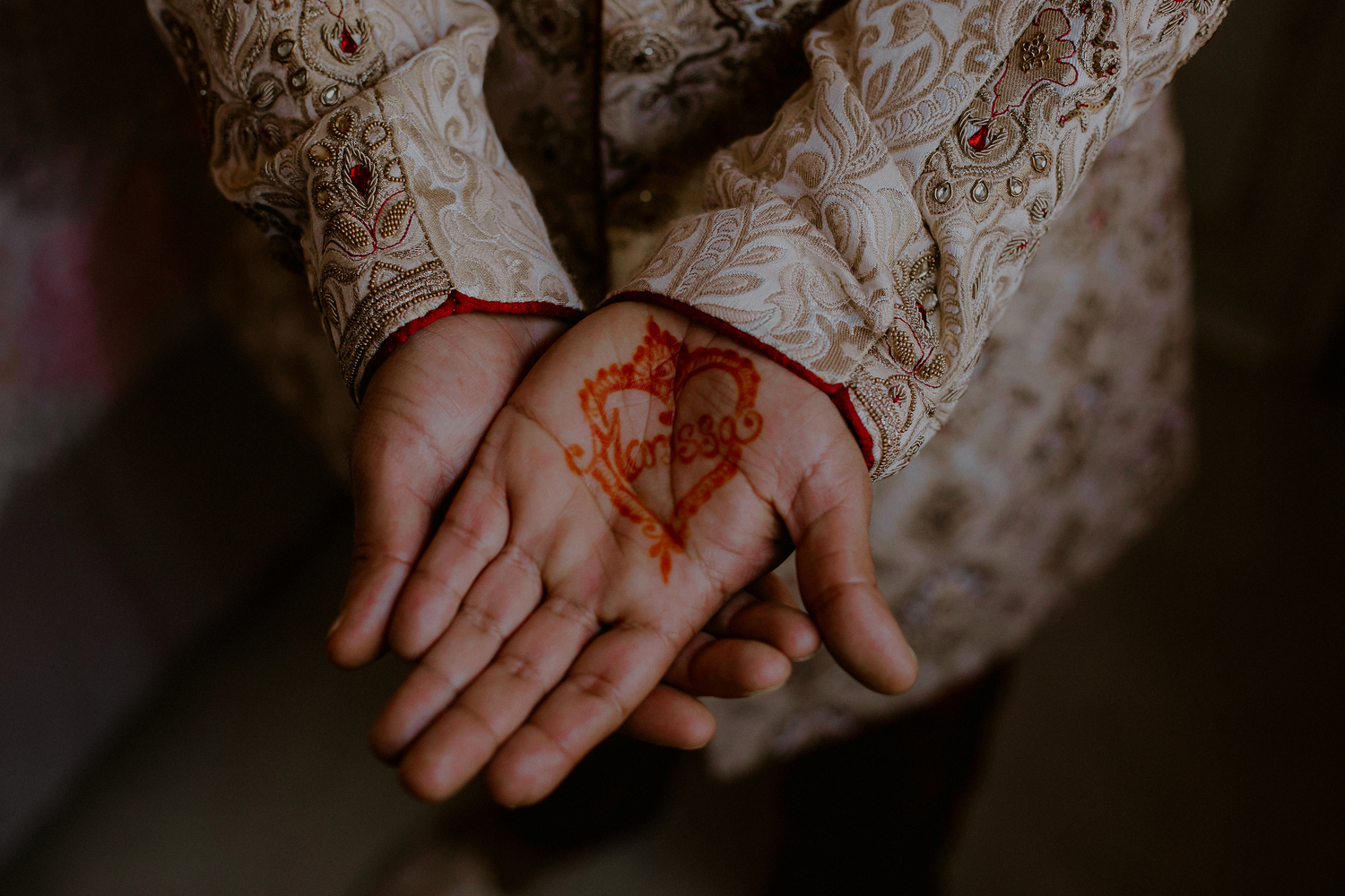 indian groom's henna on hands