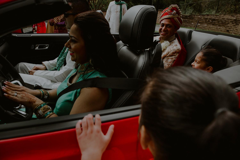 groom arrival to baraat in red corvette