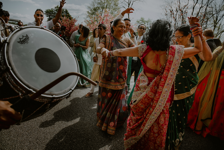 indian wedding photos of colorful baraat
