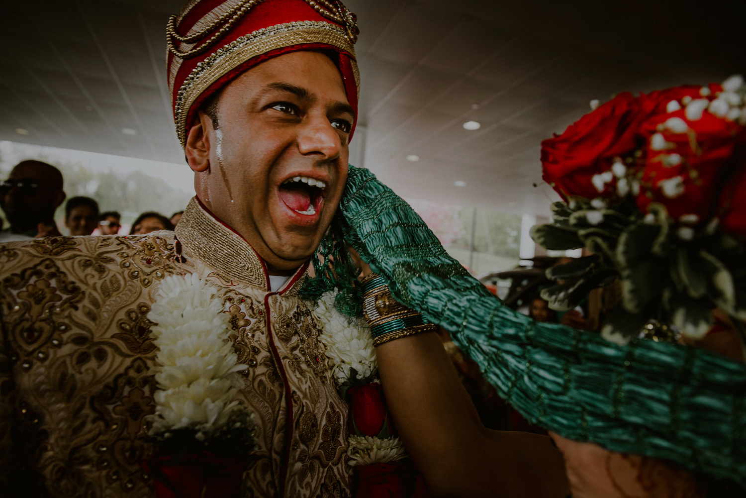 groom sweating as he enters indian wedding ceremony after baraat