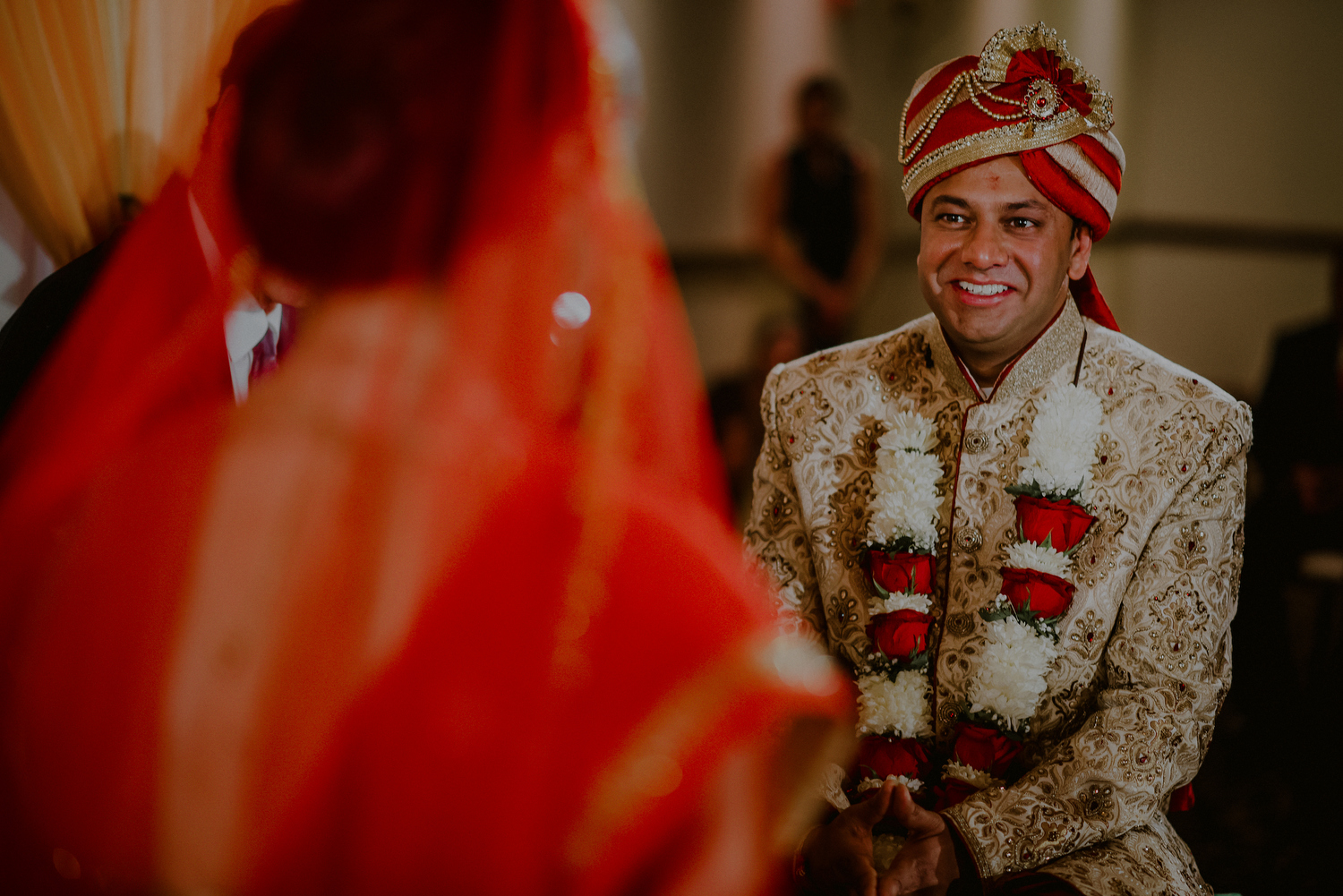 groom looks lovingly at bride during indian wedding ceremony