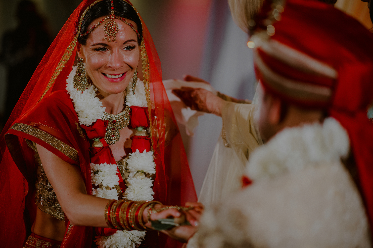 bride looks at groom during moment in indian wedding ceremony