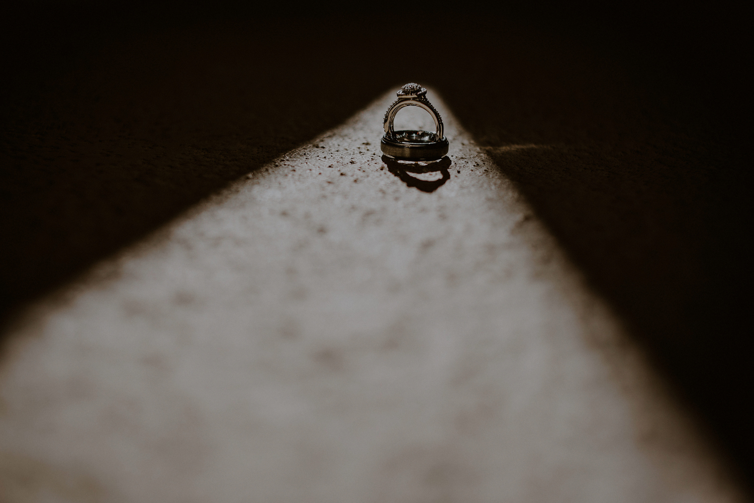 dramatic detail photo of wedding rings