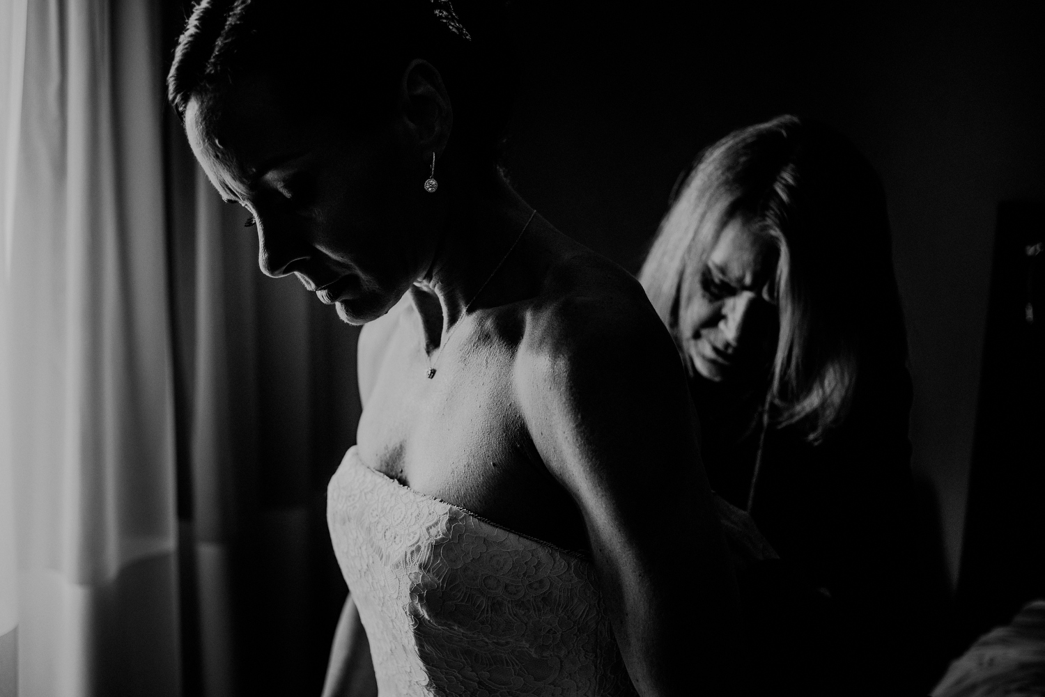 dramatic black and white photo of bride getting ready