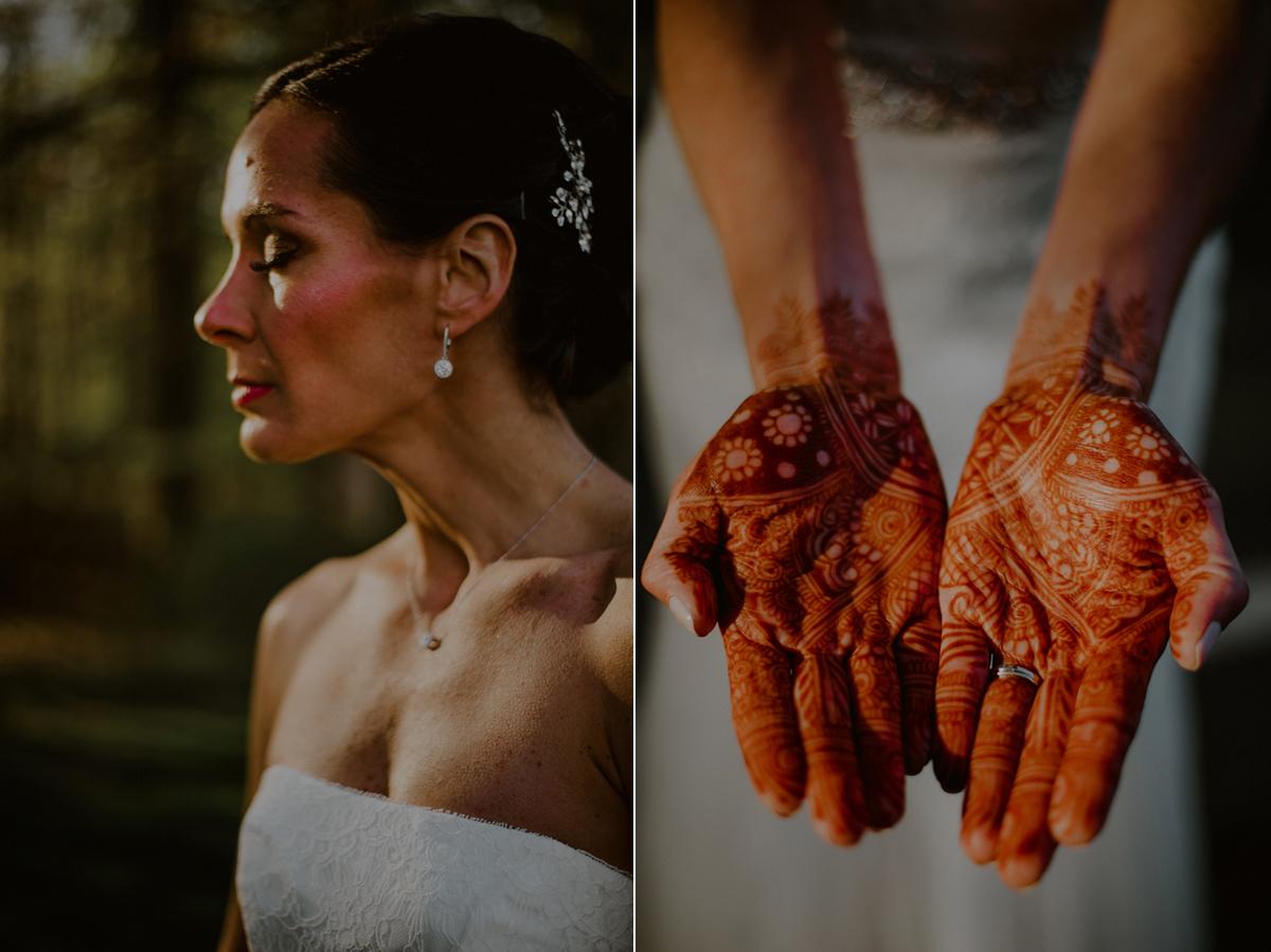 bride portrait displaying indian henna on hands