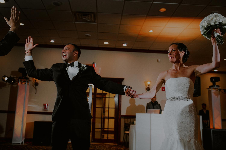 bride and groom entrance to wedding reception