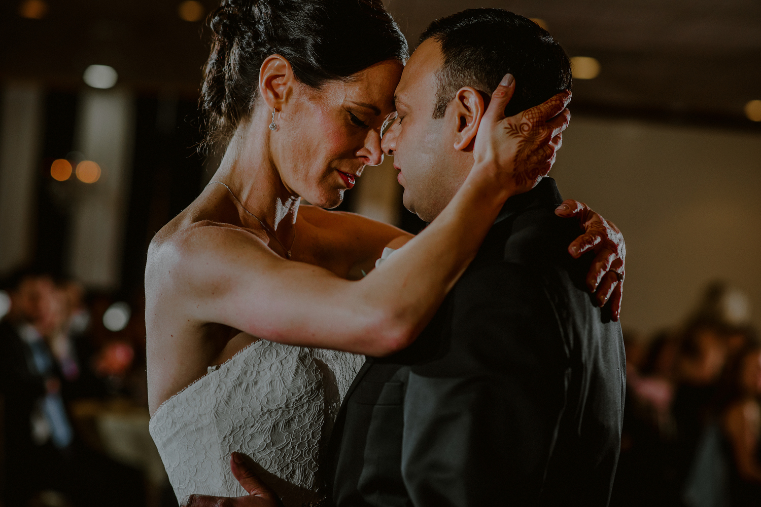 bride and groom emotional first dance