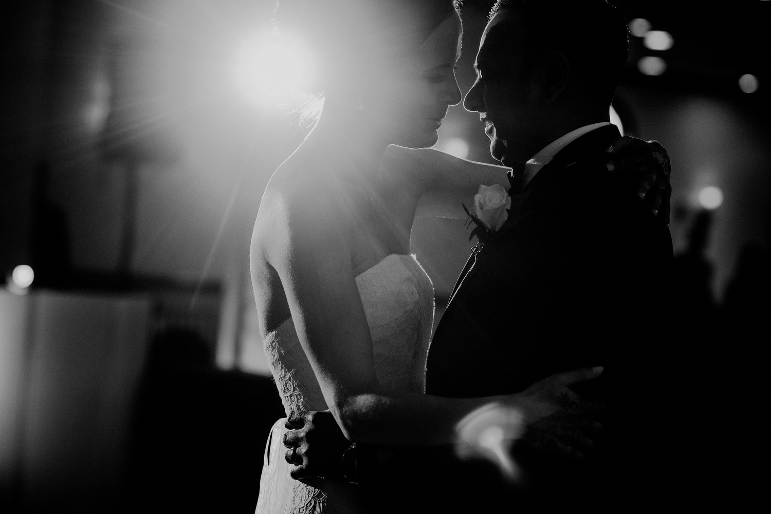black and white picture of wedding couple first dance