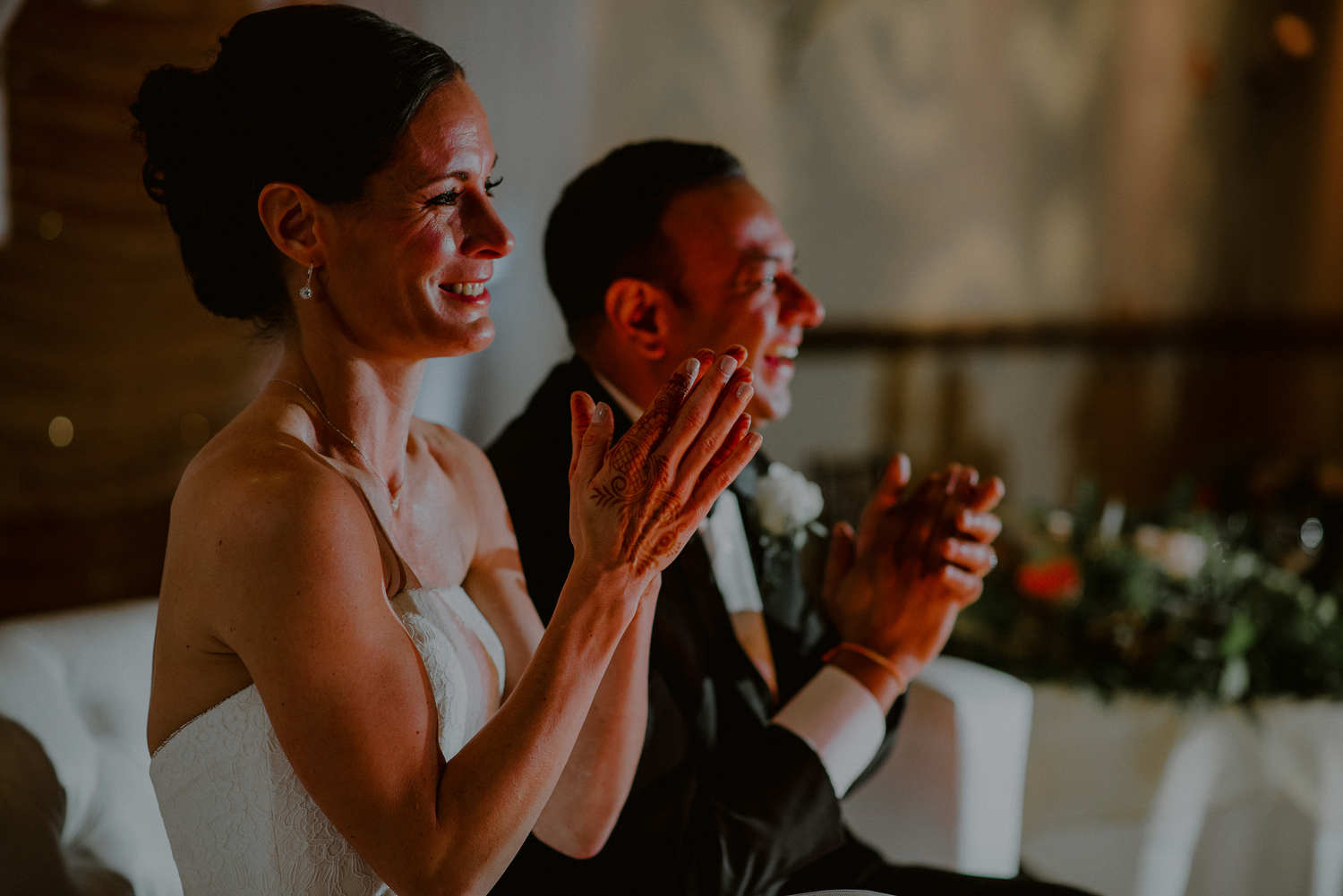 creative photograph of couple laughing during speeches