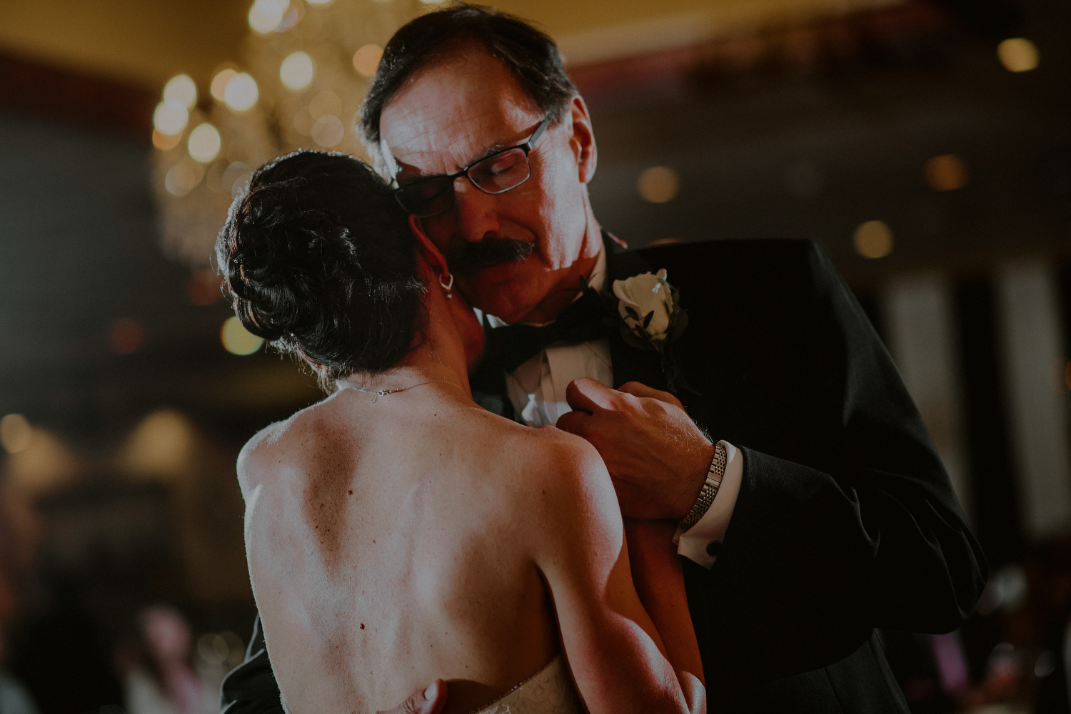 emotional father daughter dance during wedding reception