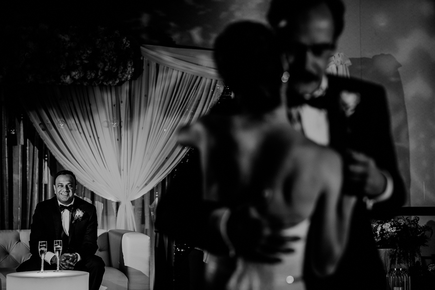 emotional father daughter wedding dance as groom looks on