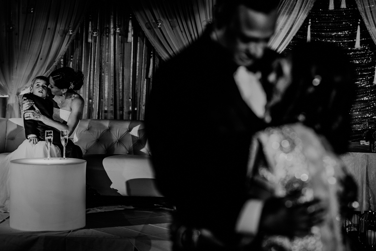 layered image of mother son dance and bride in background during wedding reception