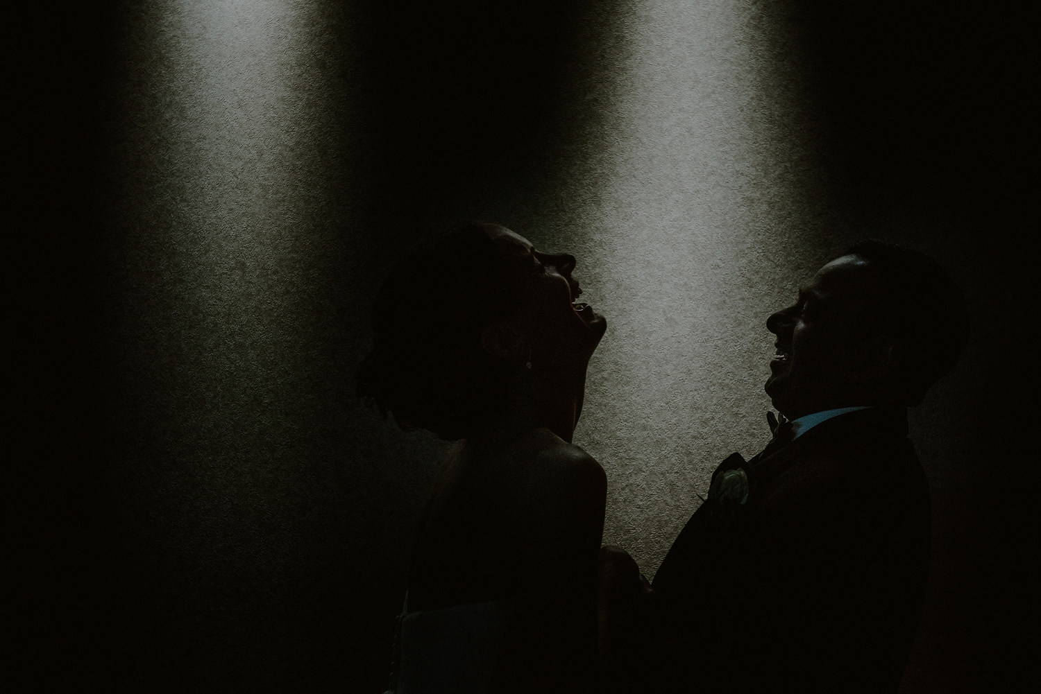 creative end of the night photo of bride and groom laughing