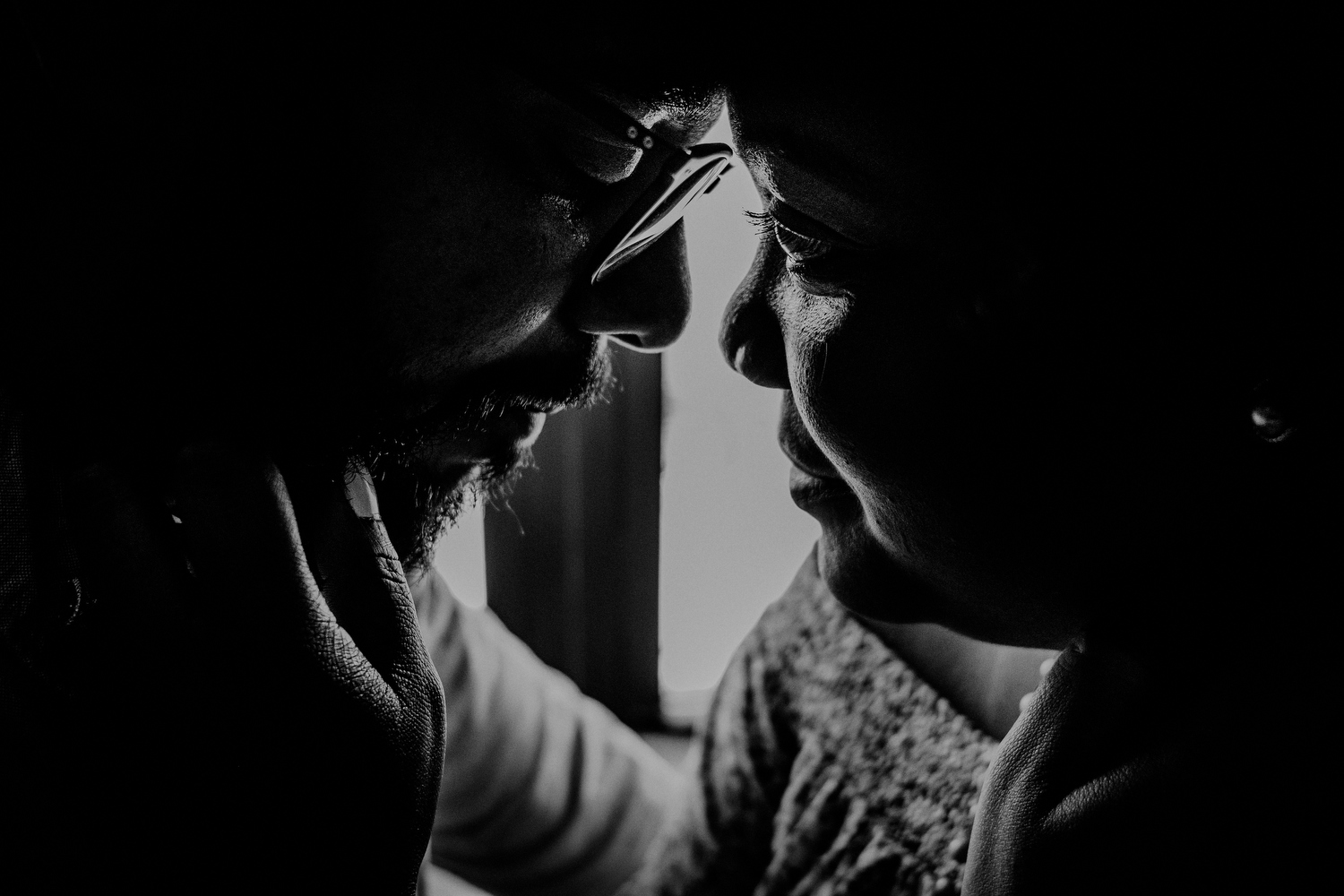 emotional queens ny engagement photos of couple in black and white