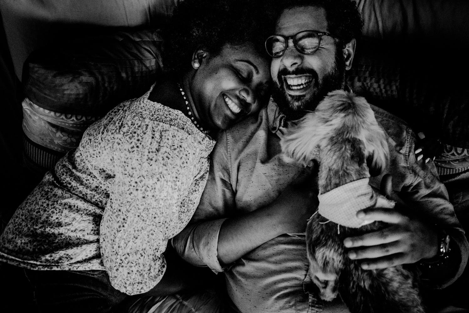 natural queens ny engagement photos of couple in home with dog