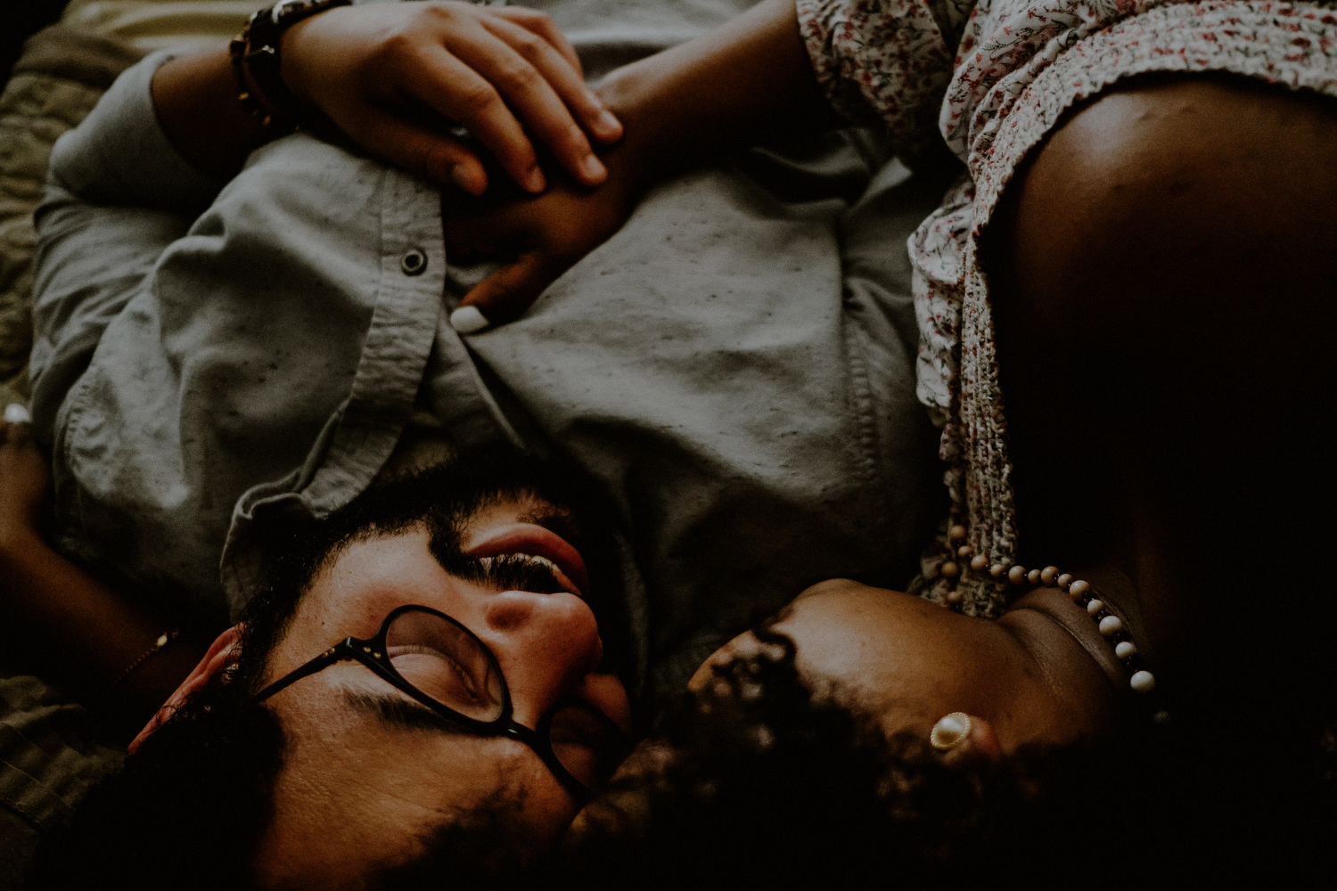 intimate queens ny engagement photos of couple on bed laying down