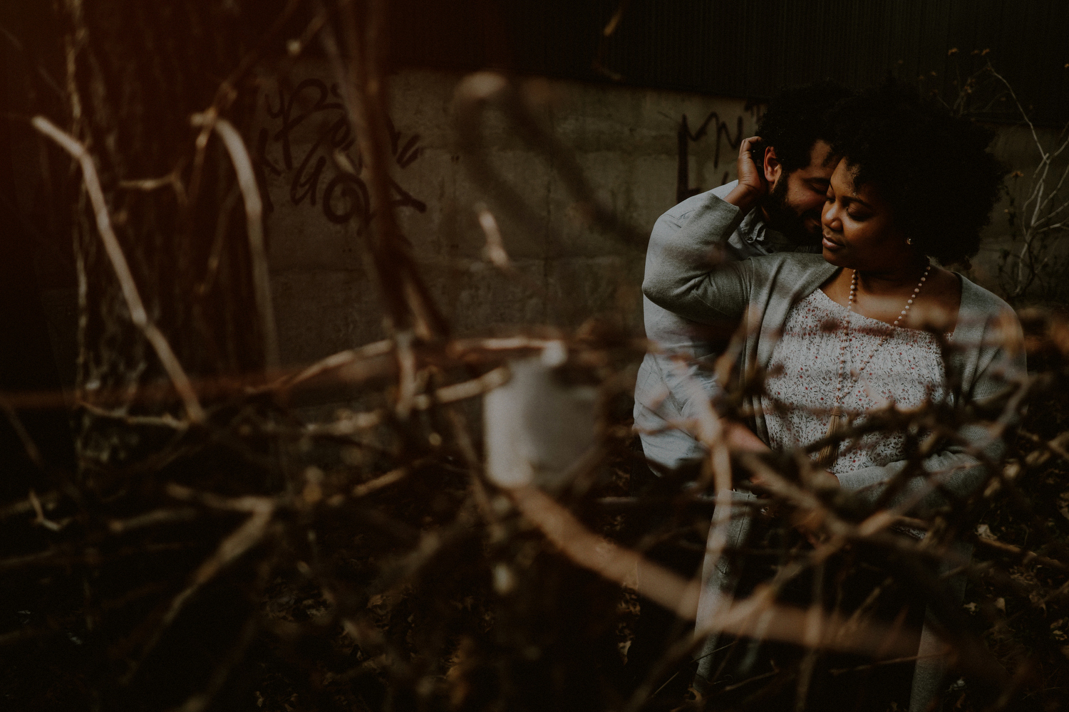 dramatic engagement photo of couple in urban environment