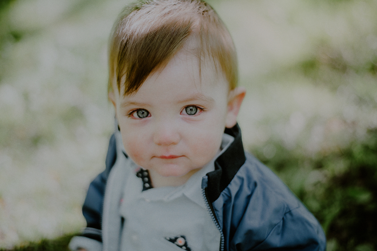 blue eyed infant looking into camera