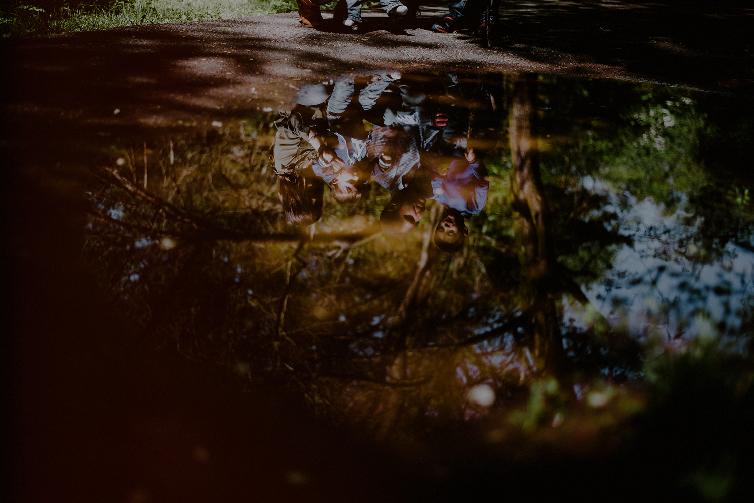 creative photo of family reflection in a puddle