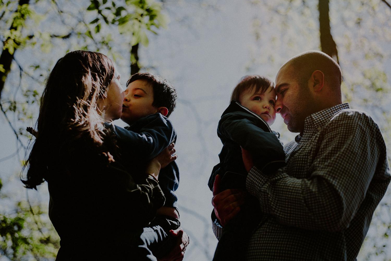 spring family photo against morning sunlight in park