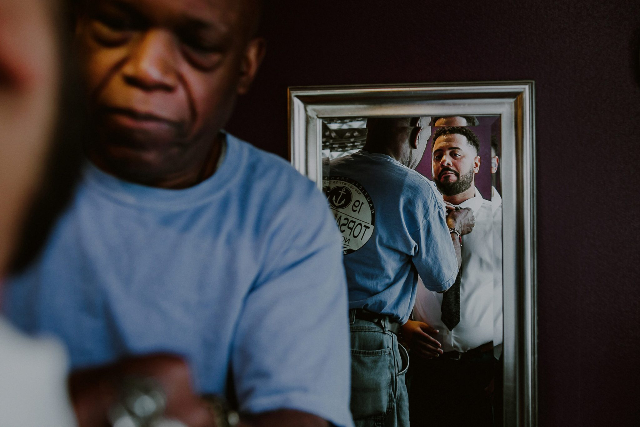 groom gets ready with dad