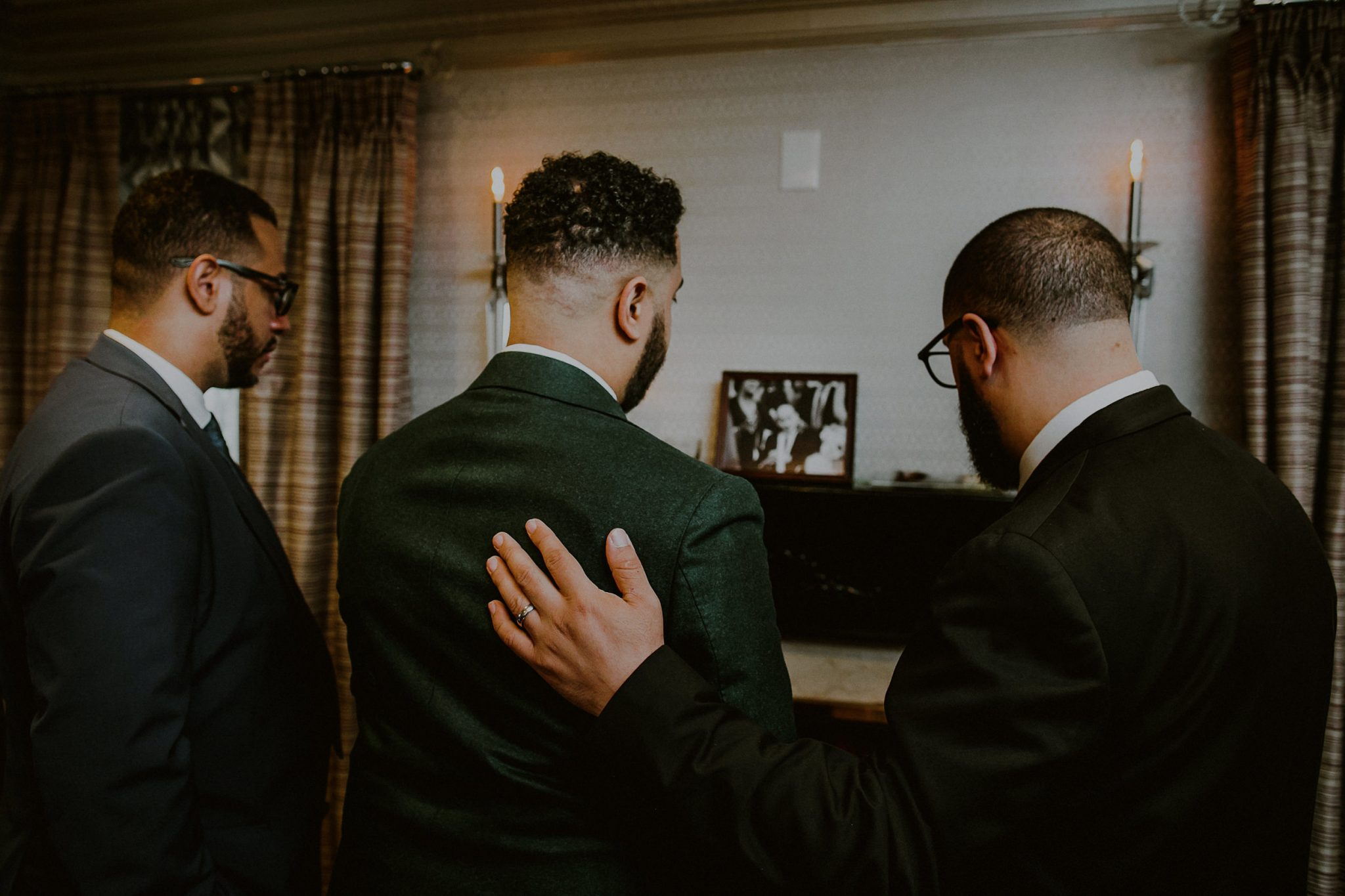 emotional moment between groom and brothers