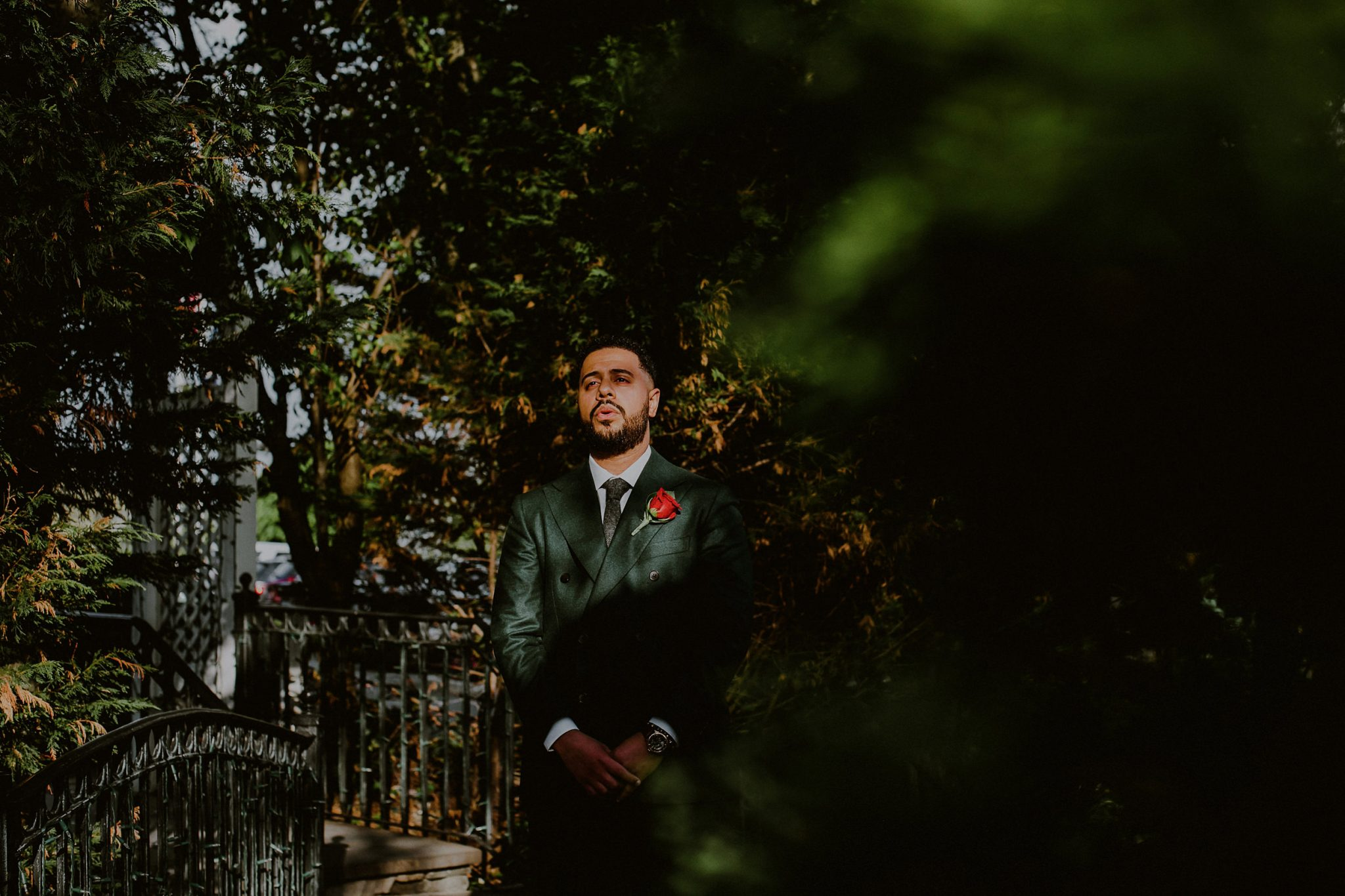 nervous groom waiting in sunlight before first look outside of fox hollow caterers