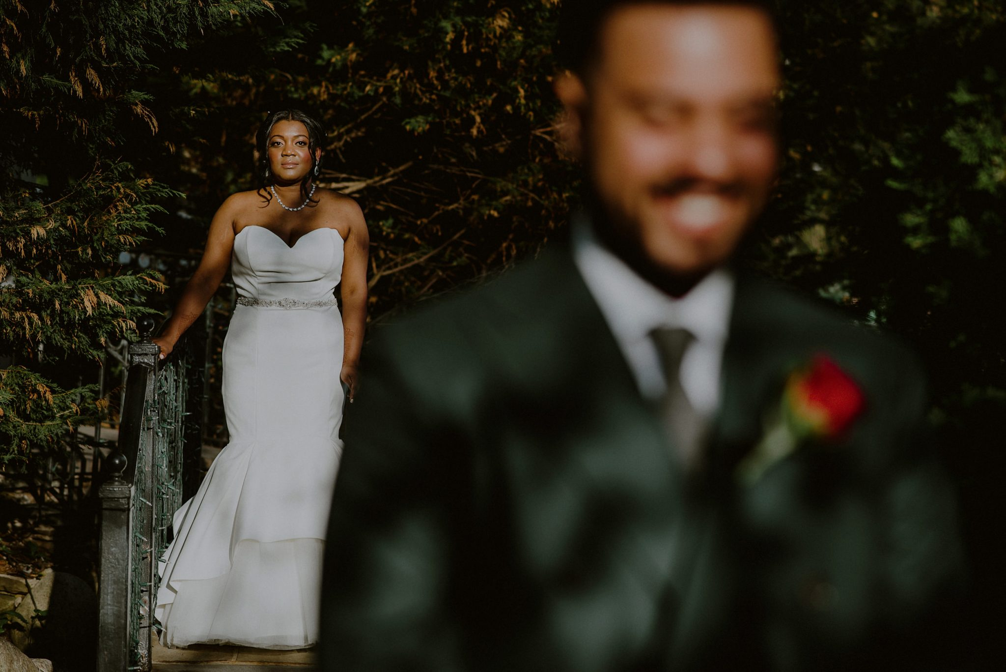 bride waits in distance before first look with groom