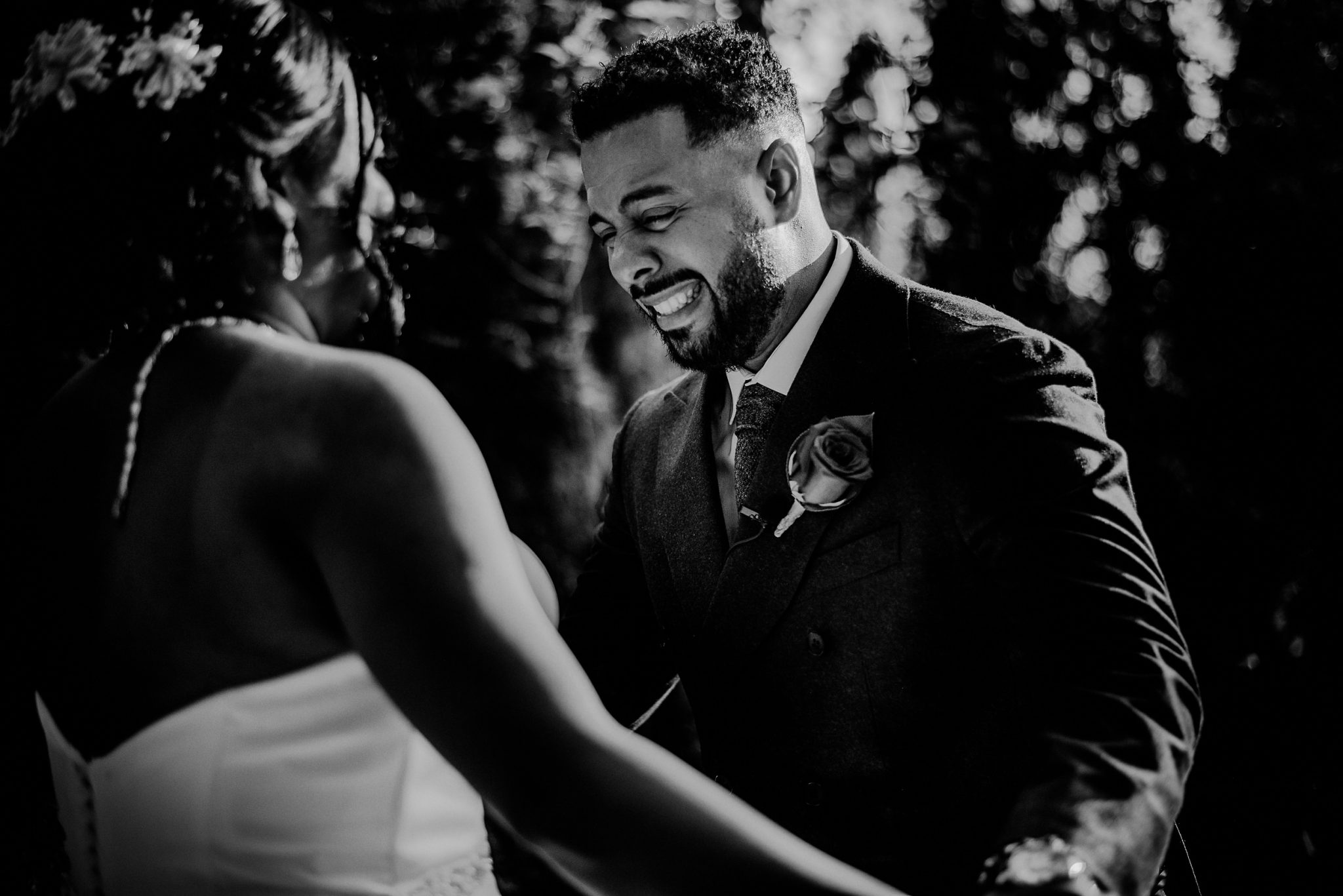 emotional groom during first look outside of fox hollow wedding venue