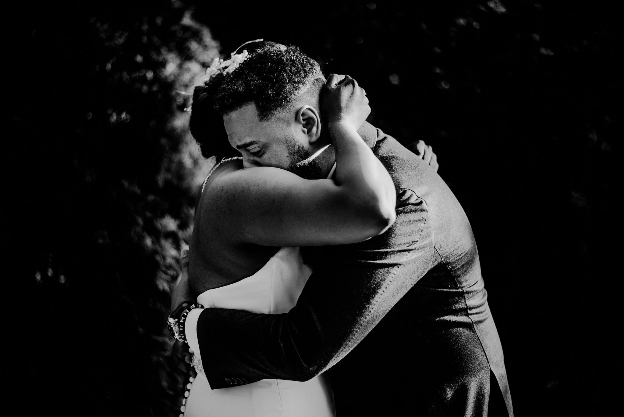emotional groom during first look embracing with bride