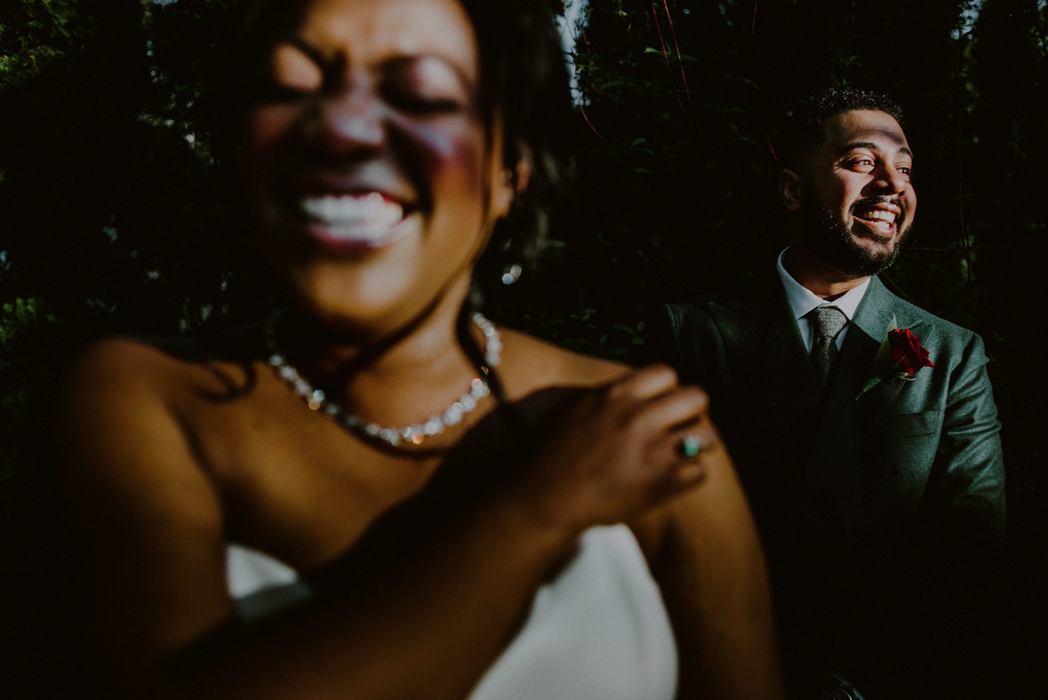 funny creative bride and groom portrait outside of spring wedding at fox hollow