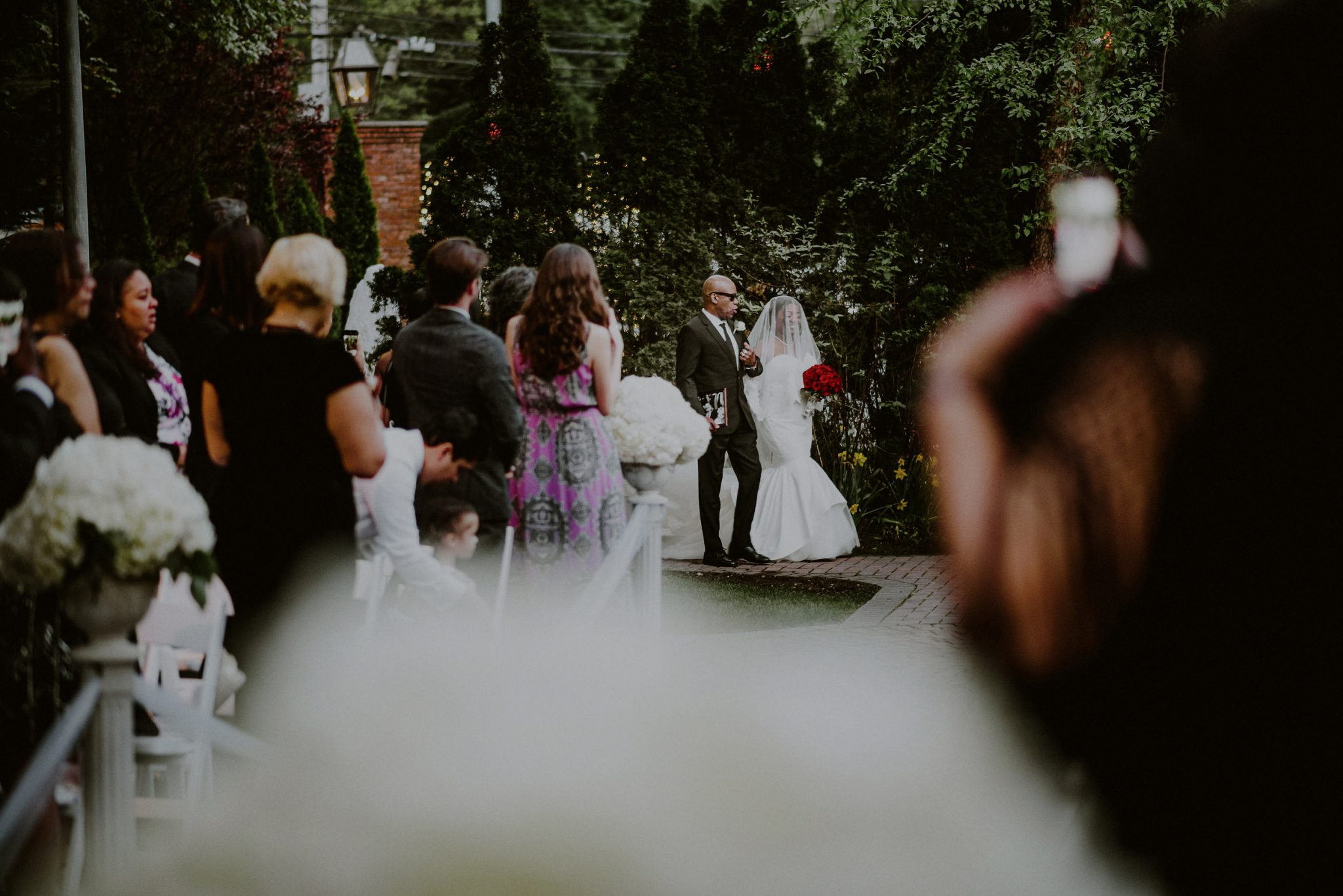 bride walks down the aisle with father during her fox hollow wedding