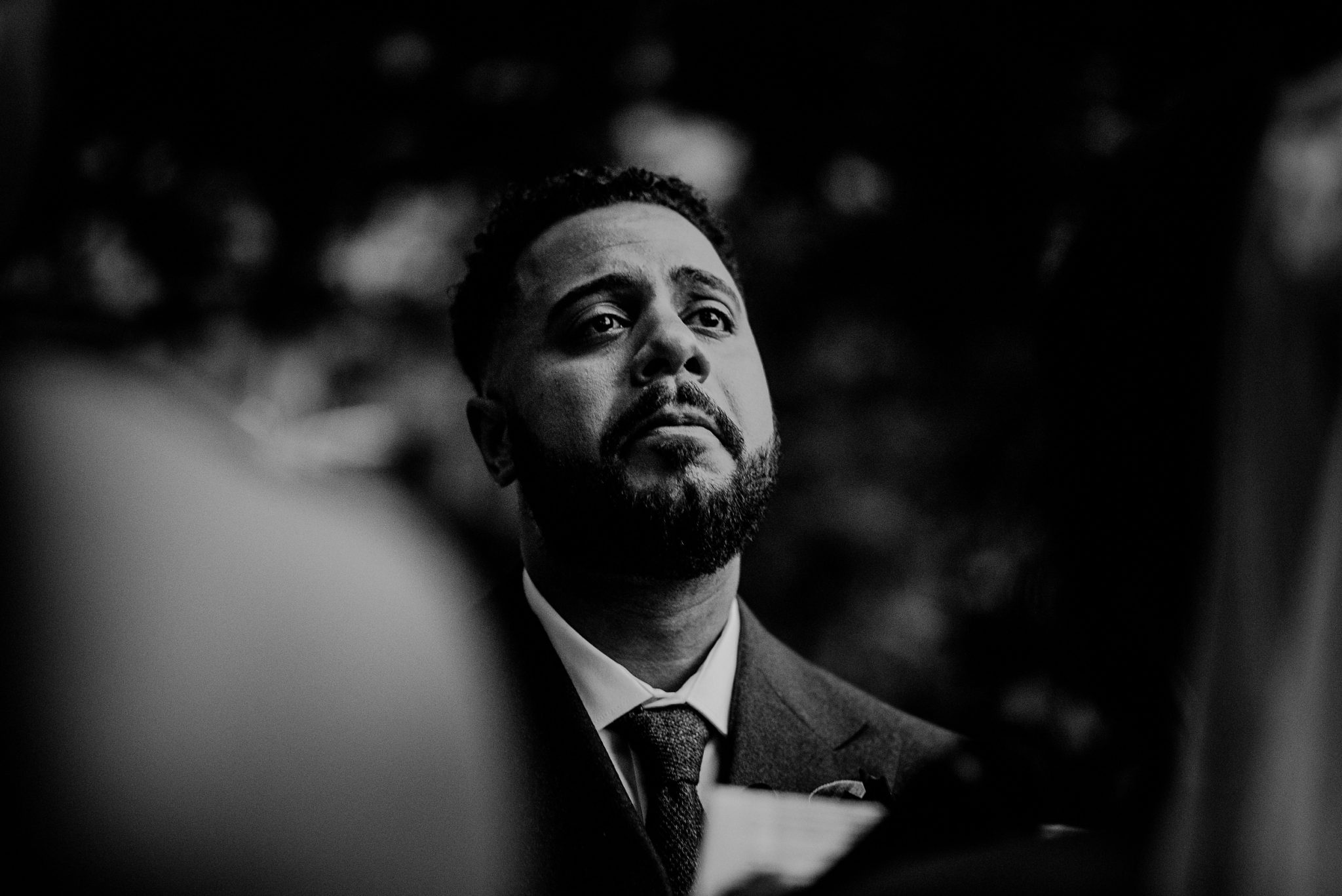 black and white photo of emotional groom