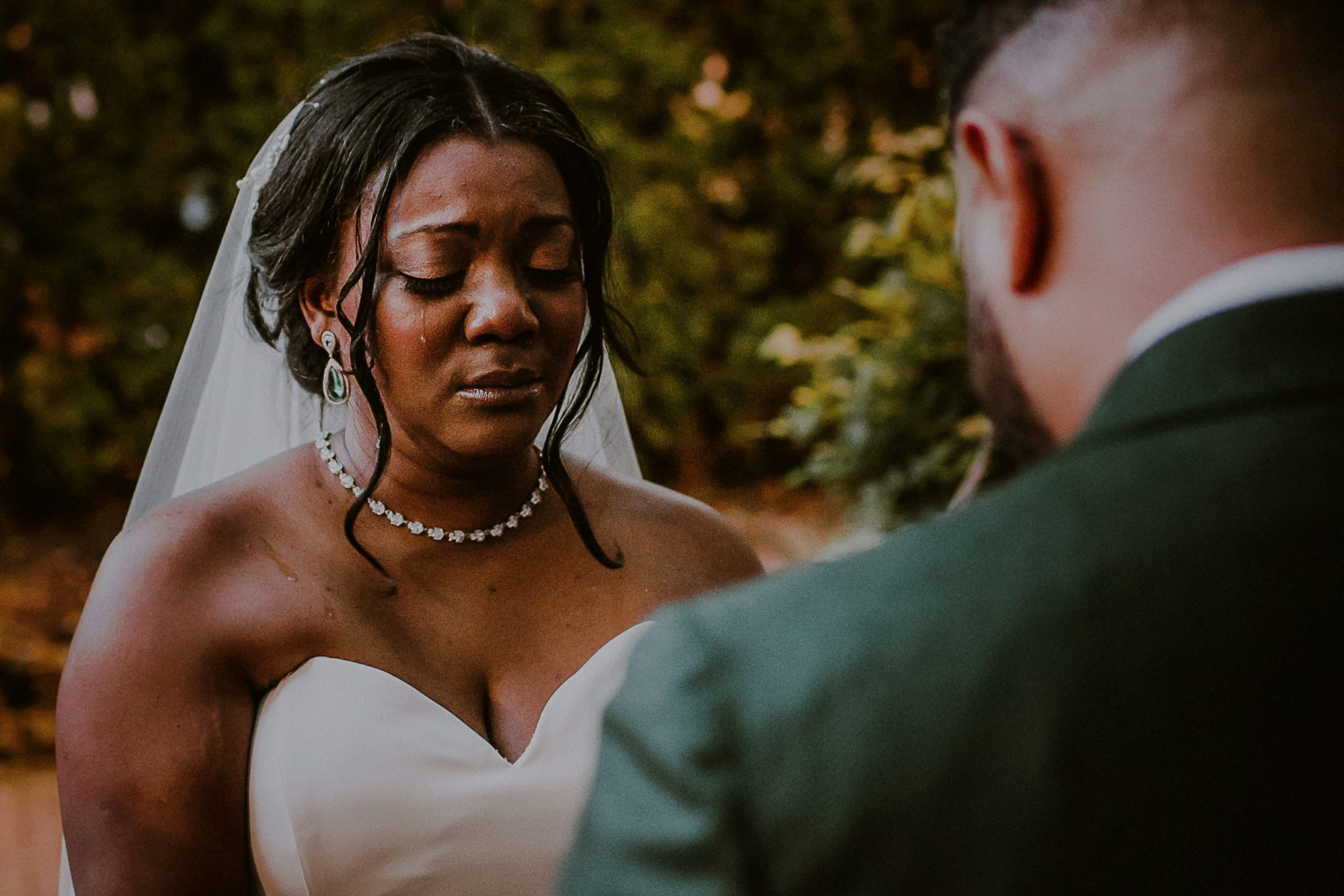 crying bride during wedding ceremony
