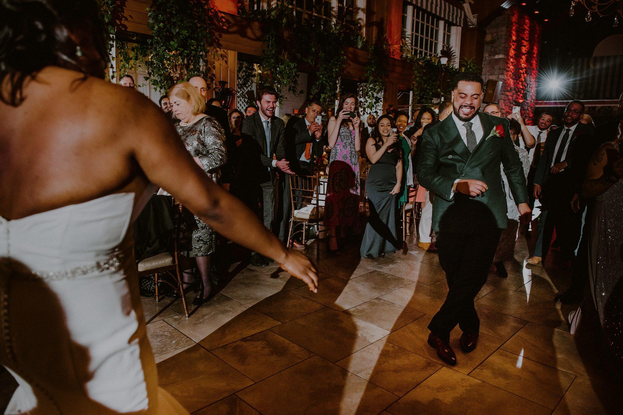 bride and groom dance into wedding entrance