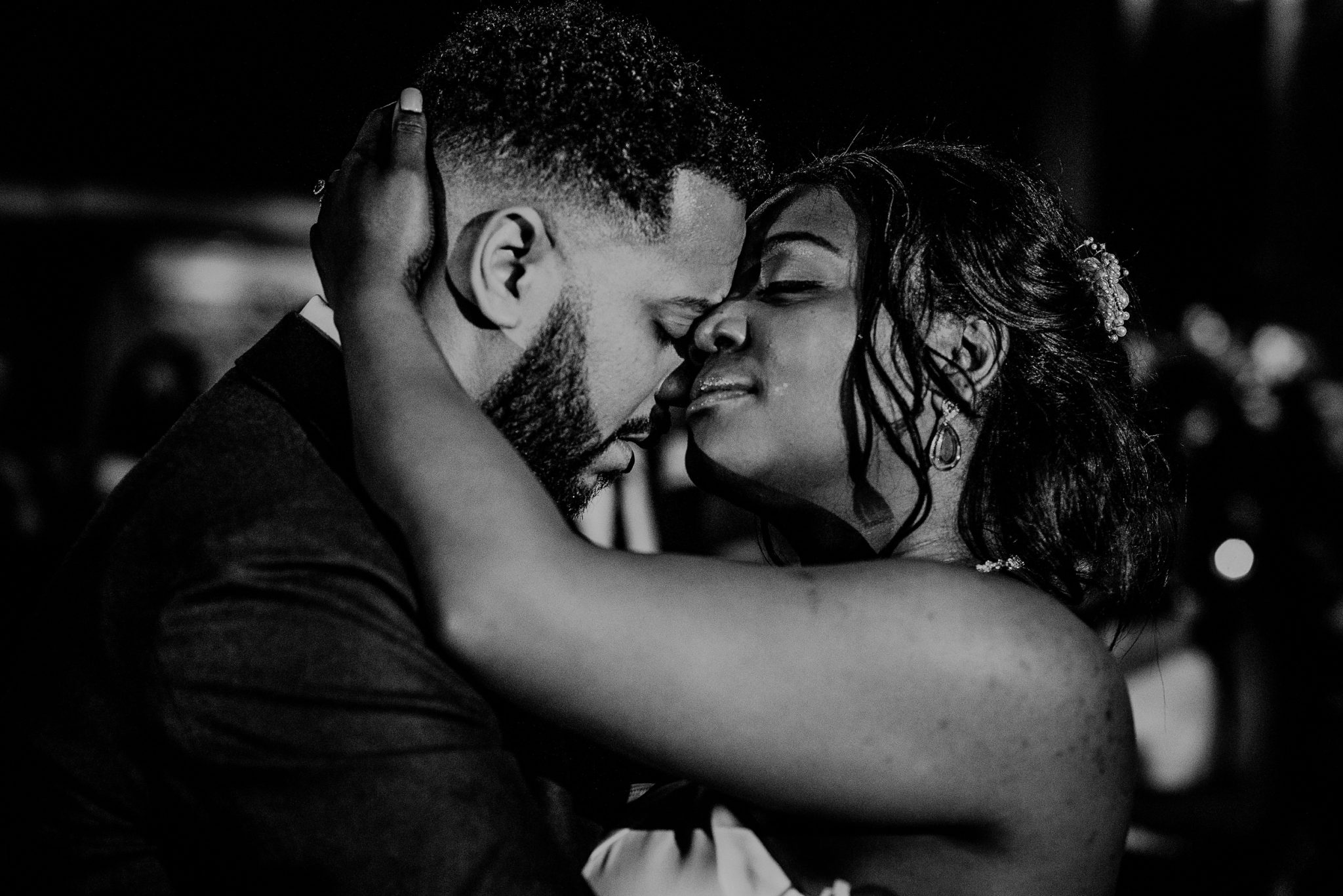 emotional black and white photo of bride and groom first dance