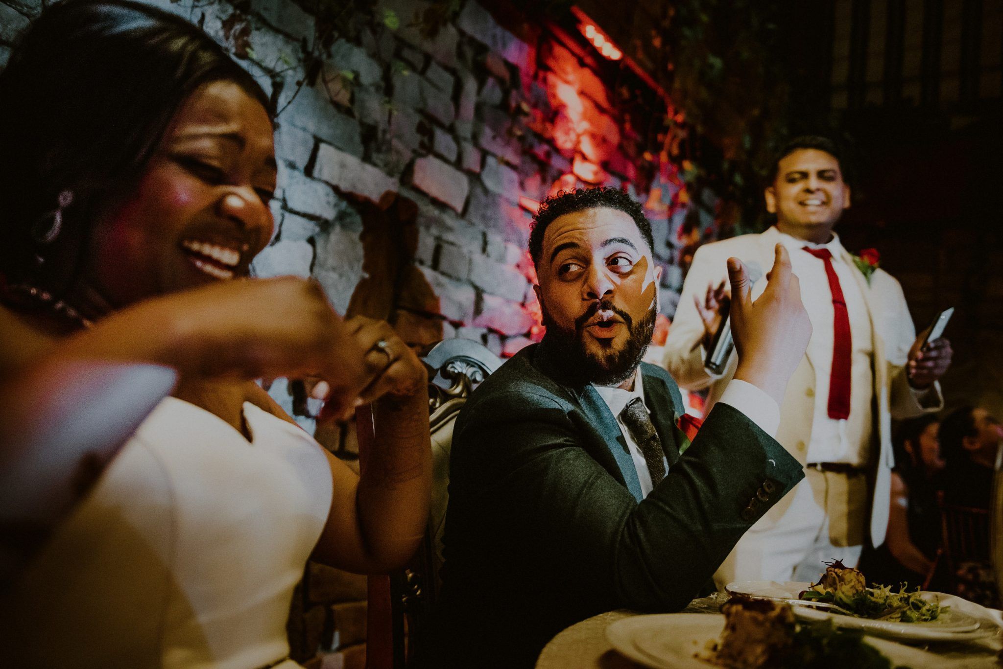 bride and groom laughing during funny best man speech
