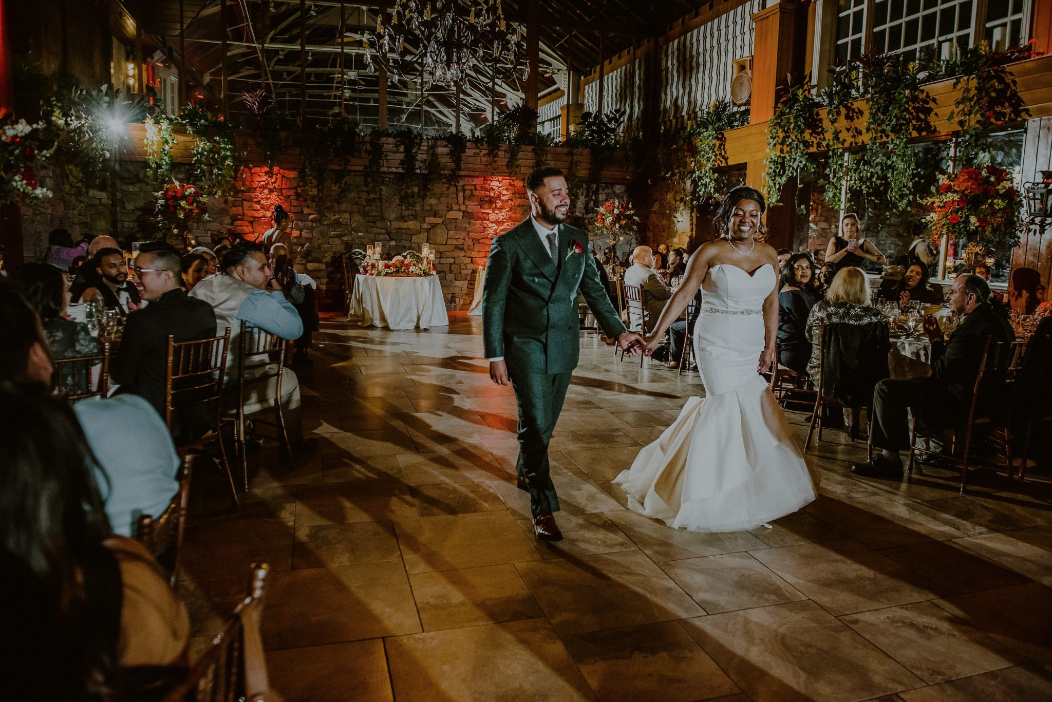 bride and groom at their fox hollow wedding surrounded by guests