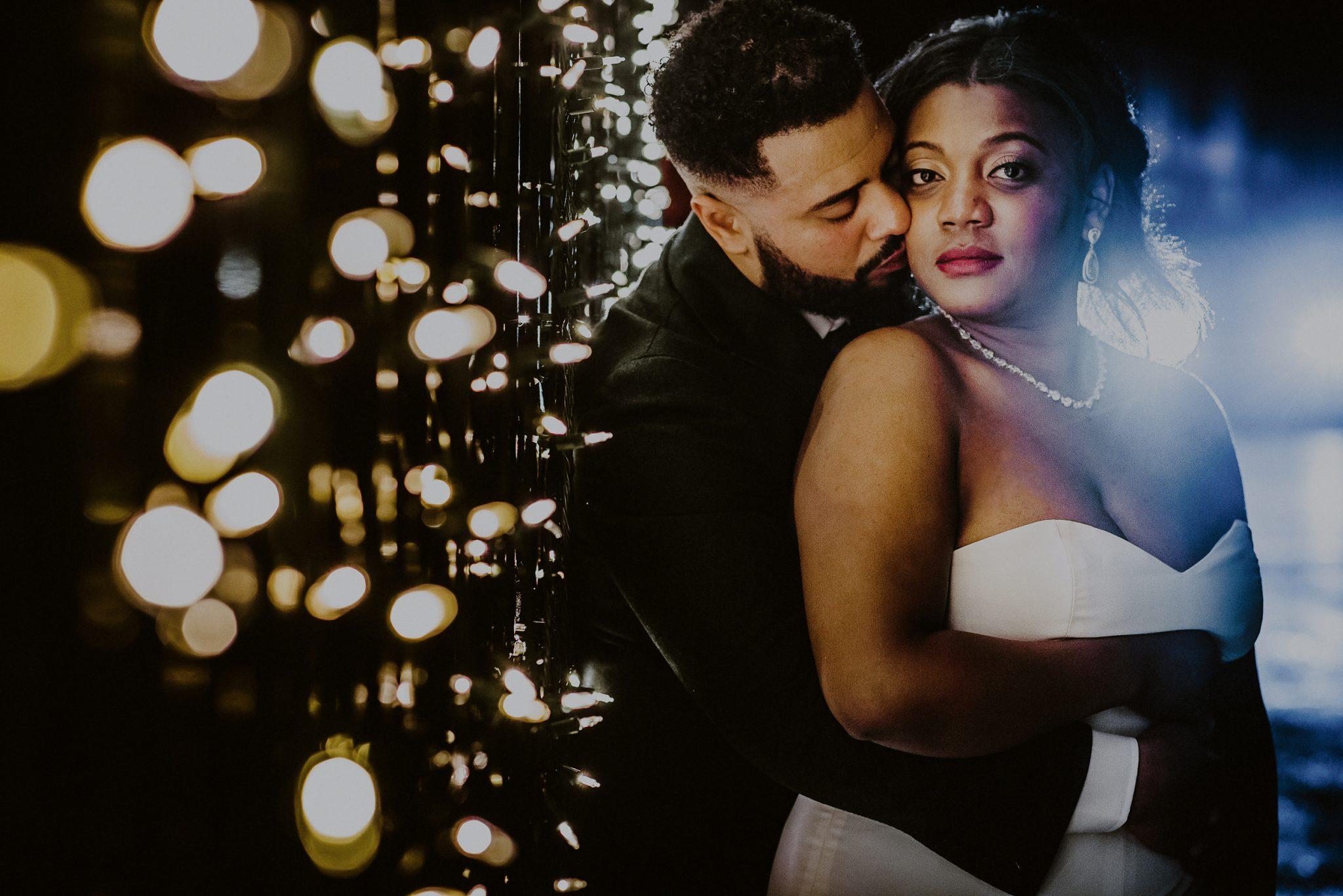 creative night wedding photo of bride and groom outside of fox hollow wedding venue